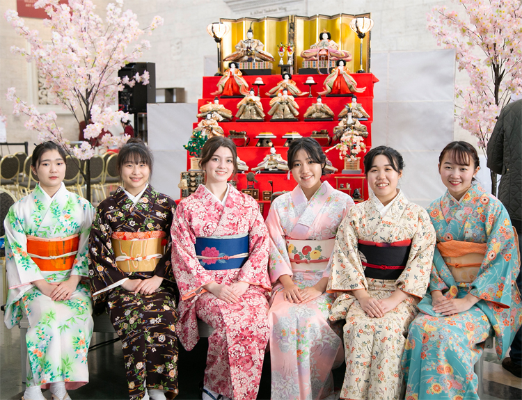 "High school students "" Sencha Girls"" , in front of Hina Dolls"